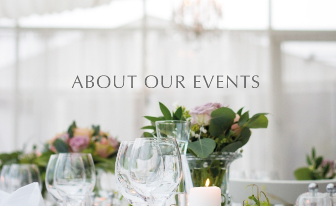 about our events image with wine glasses and floral arrangements