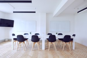White classroom setting with black chairs