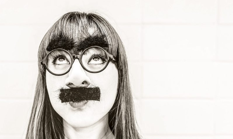 woman with glasses, fake moustache and eyebrows