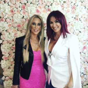 Starlight venue dressing floral wall image with housewives of cheshire at charity event