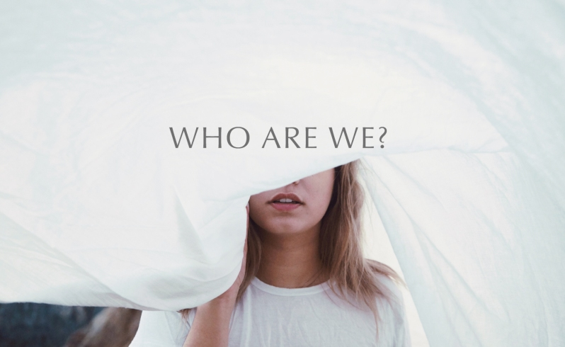 who are we image with woman covering her face with a white sheet
