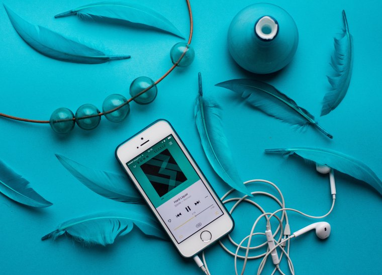 phone with earphones, turquoise